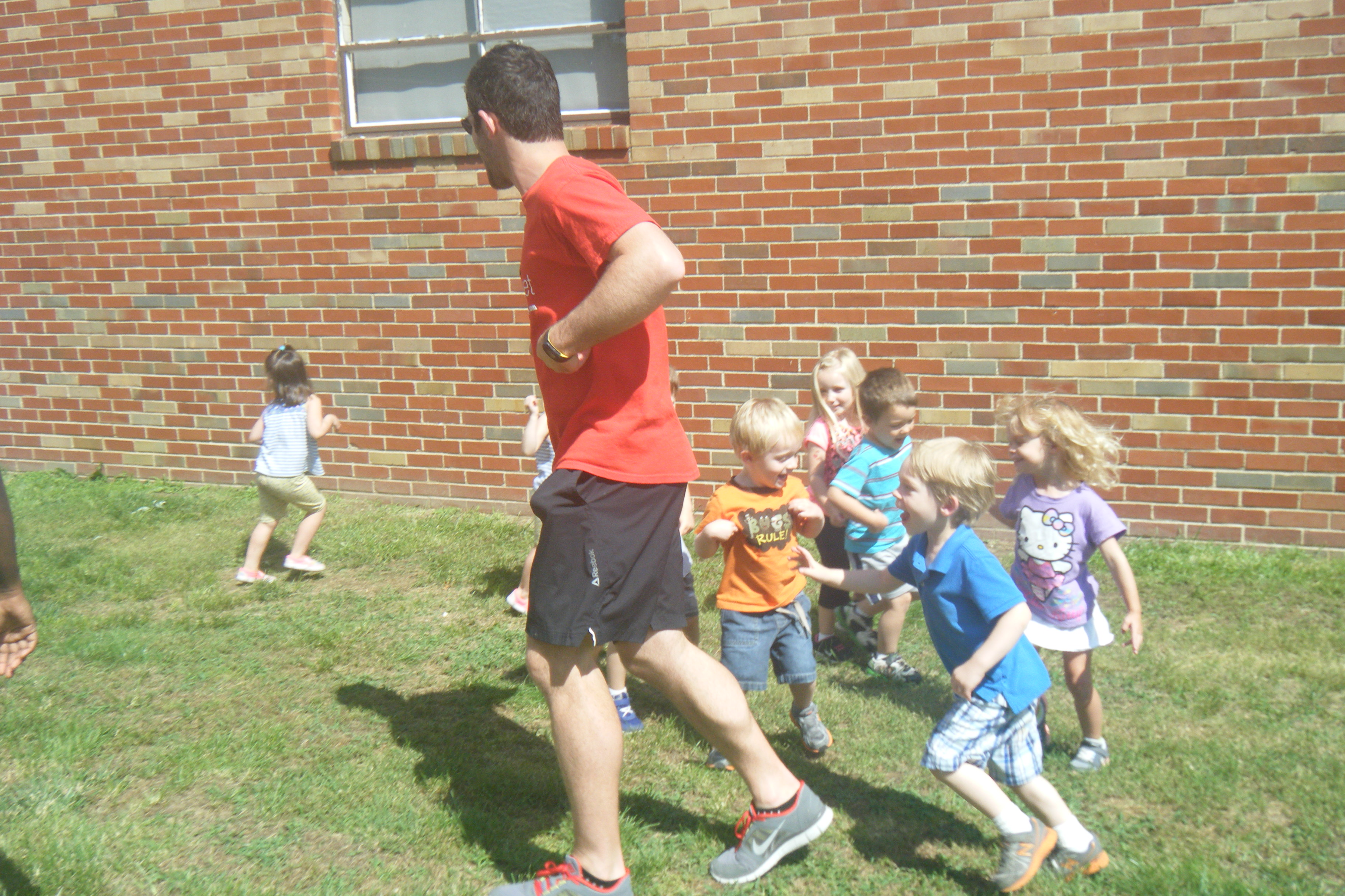Preschoolers enjoying outdoor activites on the playground.