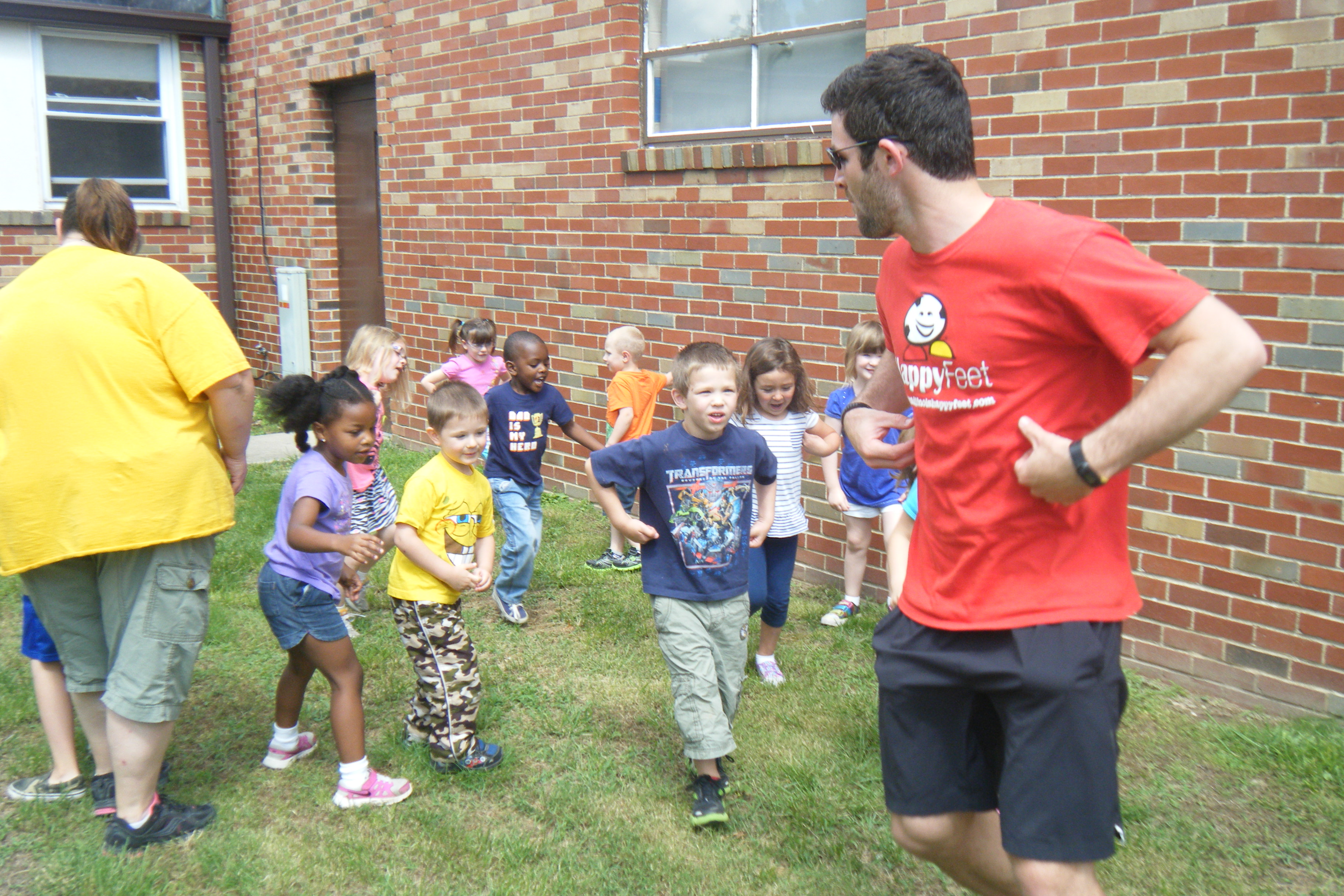 Children learning to play soccer in a safe environment.