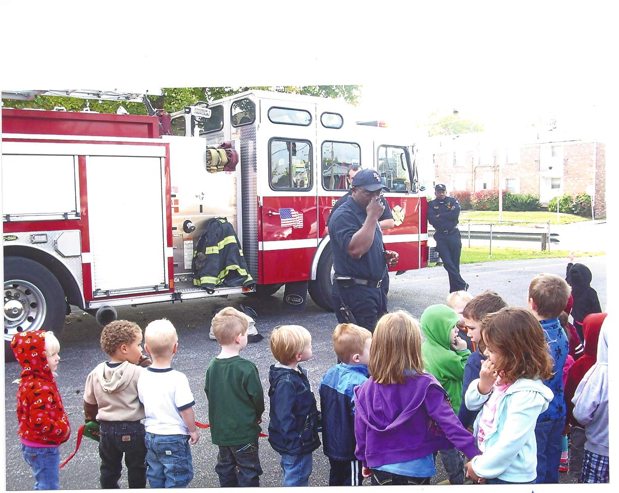 Pre-school children performing a fire drill with the Belleville Fire Department.