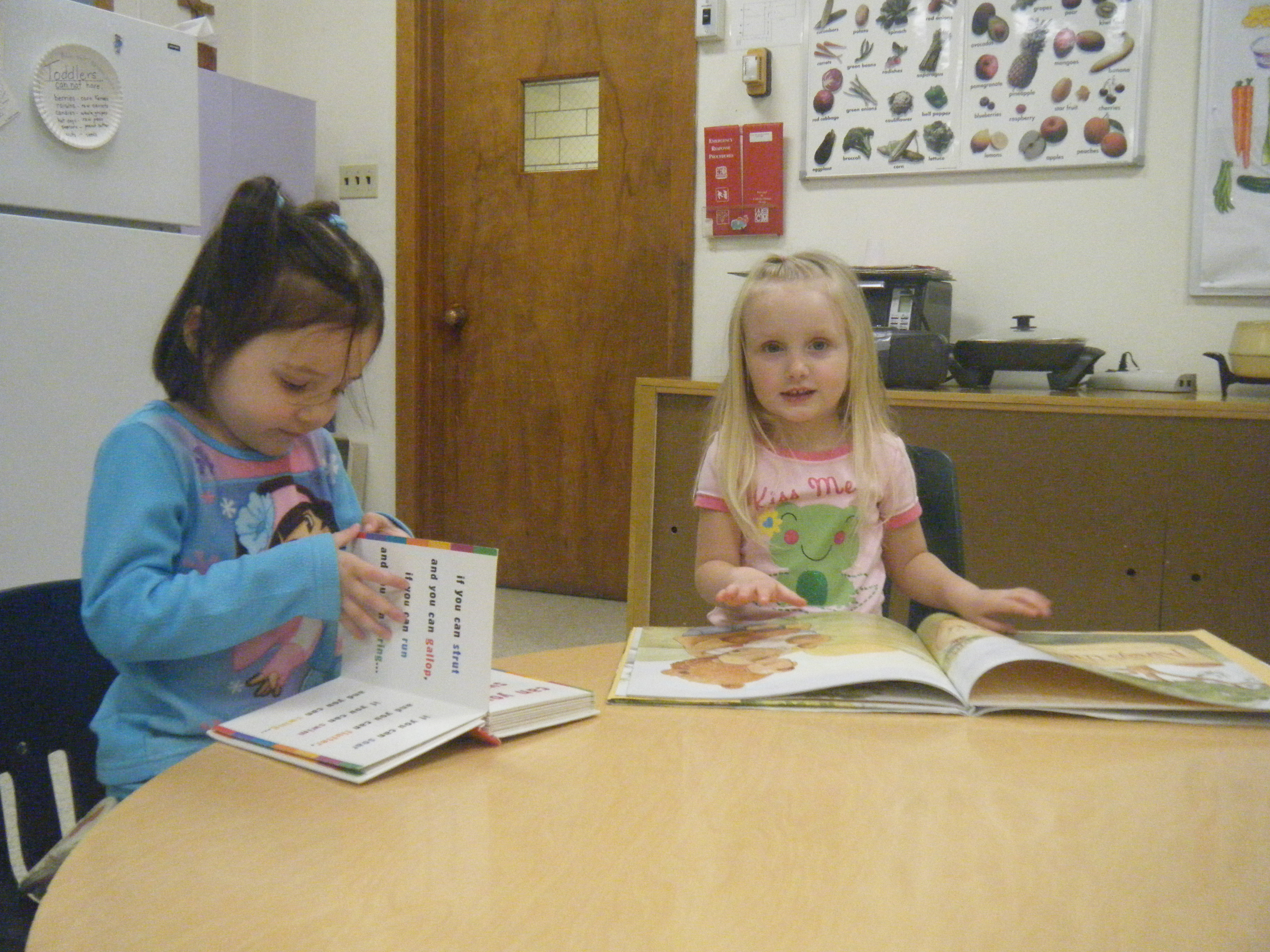 Preschool children learning to read.